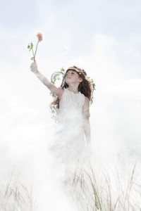 Girl dressed as fairy with flower
